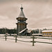 The wooden bell tower of the Pokrovskaya church.