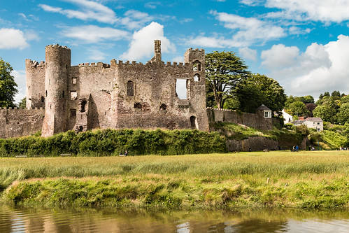 laugharne castle carmarthenshire wales ruins tower battlement fortress marsh grass rushes water tidal estuary river tree landscape building architecture