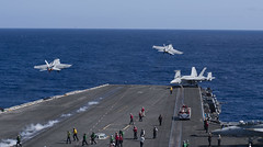 Two F/A-18E Super Hornets take off from the flight deck of USS Carl Vinson.