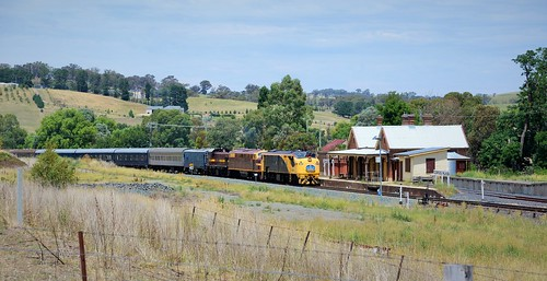 Passing by the former station at Georges Plains, 42103+4204+4716 lead the 'Blue Suede Express' westbound heading to Parkes, NSW