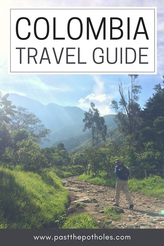 Man walking along a mountain hiking trail with text: Colombia Travel Guide