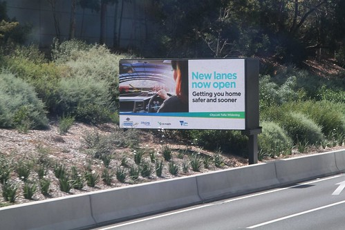 'New lanes now  open. Getting you home sooner and safer' propaganda from the CityLink Tulla Widening project