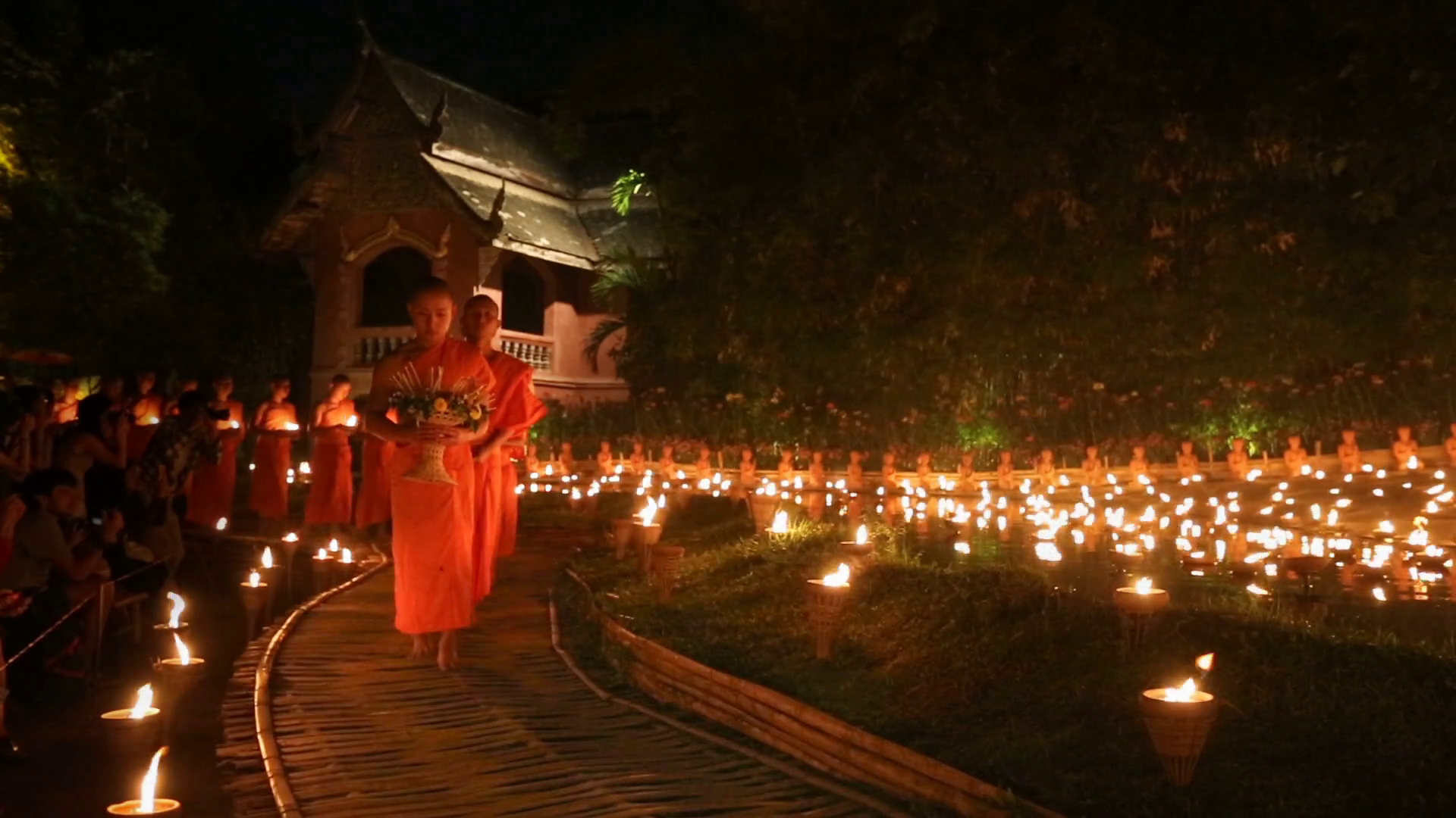 Monks lighting candles for Makha Bucha Day in Chiang Mai, Thailand.