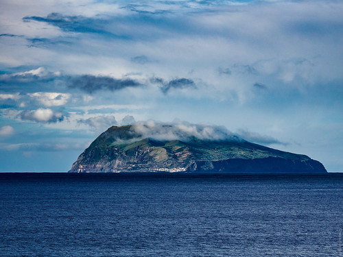 Island under clouds