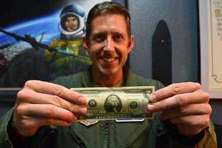 U-2 Pilot with two dollar bill