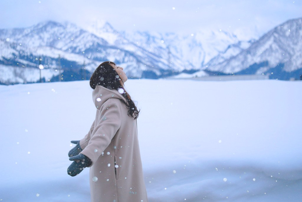 Young woman at snow field