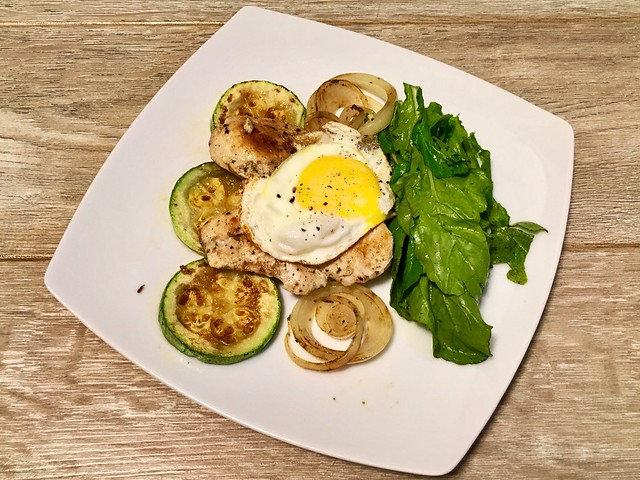 Chicken, arugula (so weird to say this!), zucchini, onions and egg
