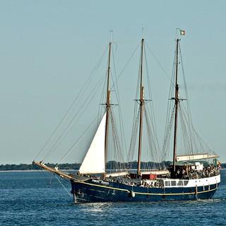 "Sailing boat ""Principe Perfeito"" ascending the Tagus River full of tourists"