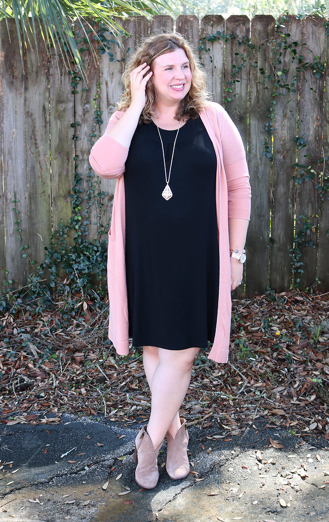 long pink cardigan, black swing dress, mushroom booties 4