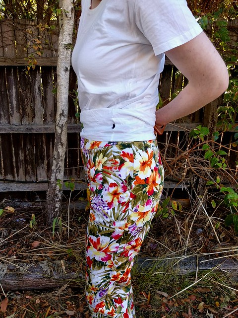Close up of a woman wearing tropical print pants