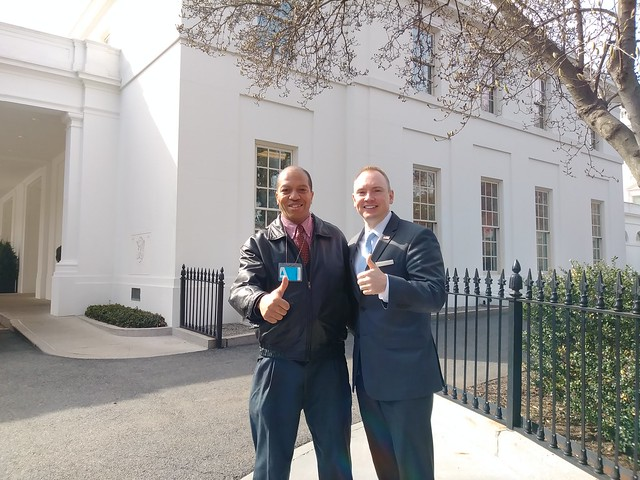 Jeff and Cliff pose together, both giving a thumbs up, just outside of the White House.