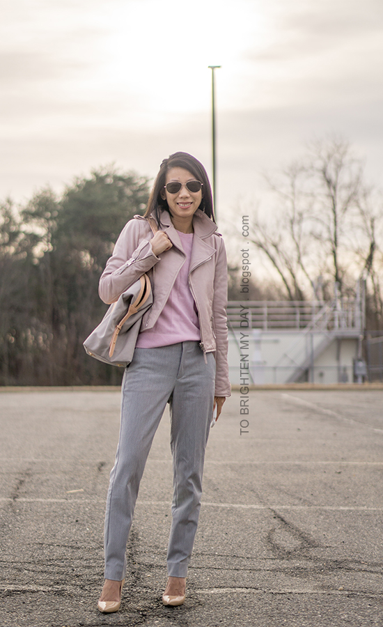 lilac leather jacket, pink sweater, gray pants, nude patent pumps, beige and gray tote