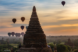 Tourists atop Buddhist temple stupa viewing sunrise and hot air balloons - Bagan, Myanmar | by Phil Marion