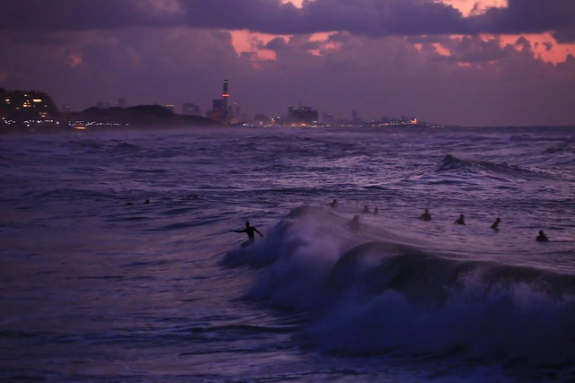 Surfing at sunset - Tel-Aviv beach