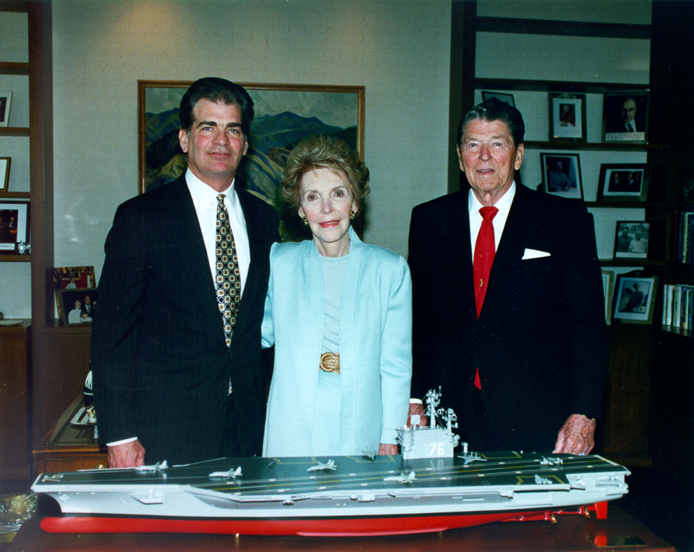 Former President Ronald Reagan and First Lady Nancy Reagan, as well as Newport News Shipbuilding Chairman and CEO William Frick stand behind the model of the aircraft carrier USS Ronald Reagan (CVN-76). The model was presented to President Ronald Reagan in May of 1996.