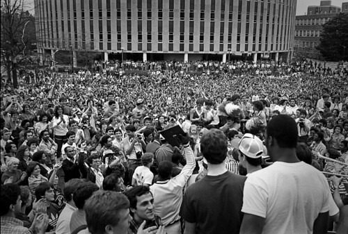 Wolfpack fans gather on the Brickyard to celebrate and honor the men's basketball team winning the 1983 ACC Tournament championship. The team eventually won the NCAA championship several weeks later. (© 1983 Roger Winstead)