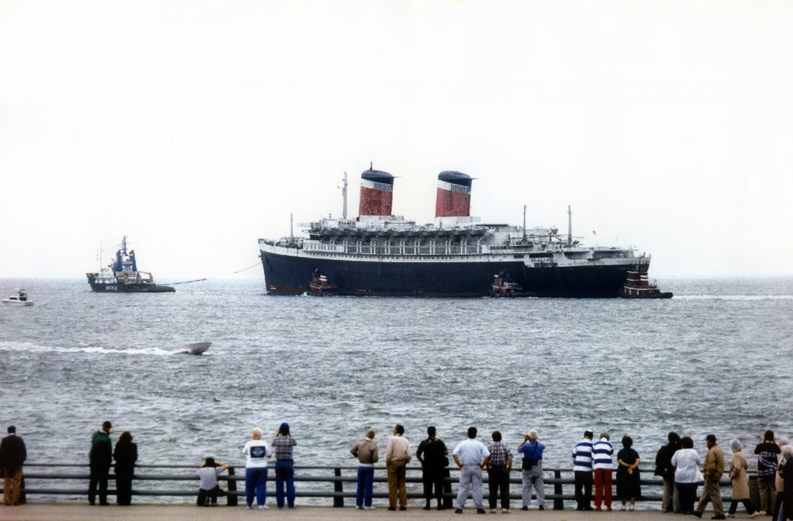 SS United States departing Norfolk, Virginia, under tow bound for Turkey, June 1992.