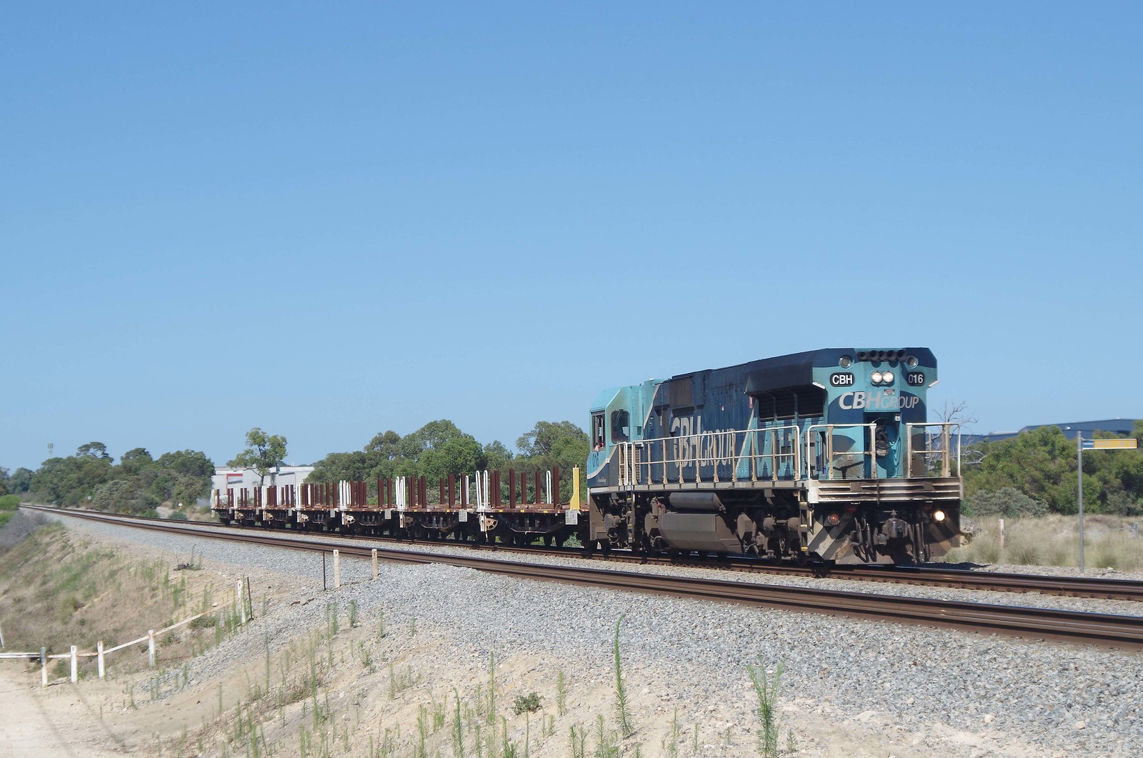 A cargo train has derailed after crashing into a car at a rail