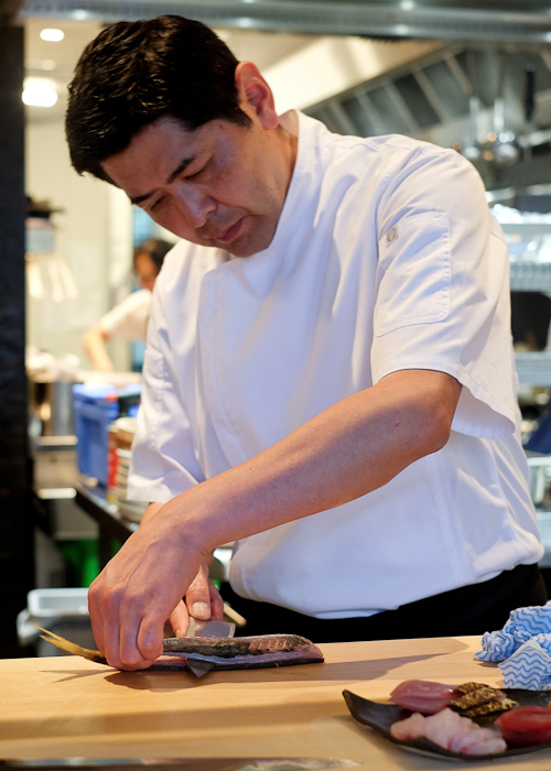 Chef Ryuichi Yoshii filleting yellowtail amberjack at Fujisaki by Lotus at Barangaroo in Sydney