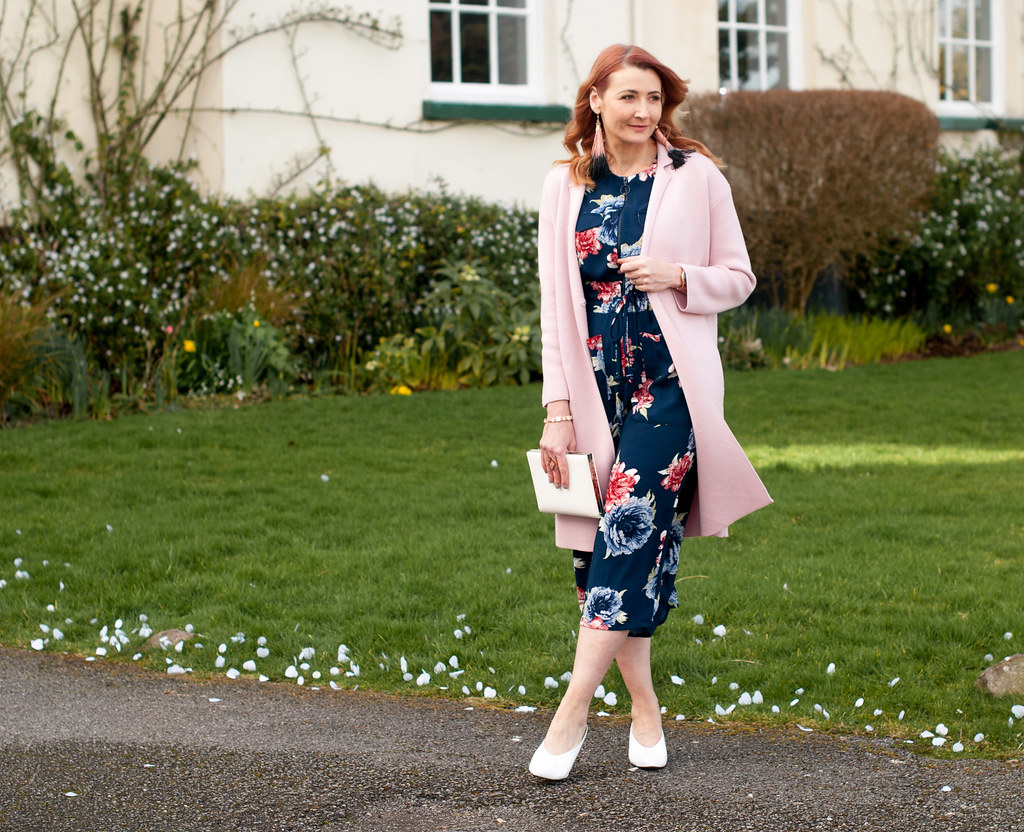 What to Wear to a Winter Wedding as a Wedding Guest - floral wide leg jumpsuit \ longline pink coatigan \ white pointed mules \ white clutch \ tassel earrings | Not Dressed As Lamb, over 40 style