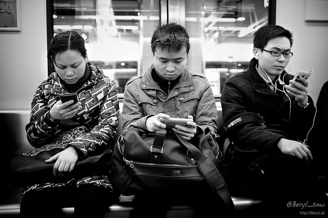 photo of people on cellphones