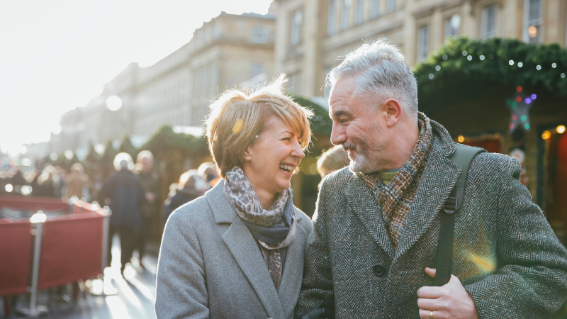 A retired couple walking in the city