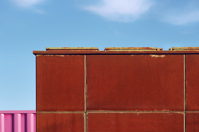 Pretty in pink. 3 clouds, 2 containers, 1 blue sky.