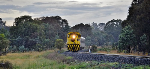 In the drizzle, 4701+4702 lead the AK cars track inspection train northbound through Clergate, NSW.