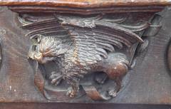 misericord: winged lion of St Mark (restored? Henry Ringham? C1860)
