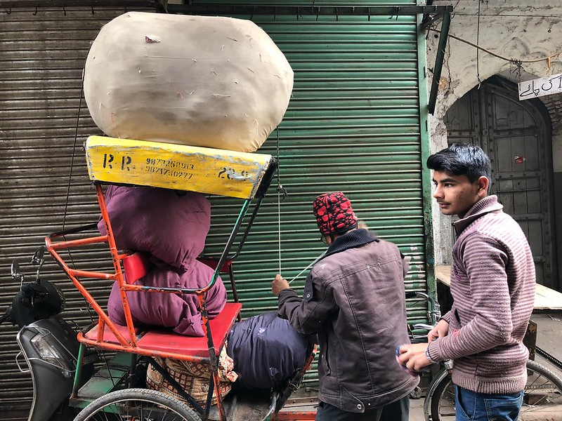 City Moment - A Rickshaw Puller's Business Negotiations, Central Delhi