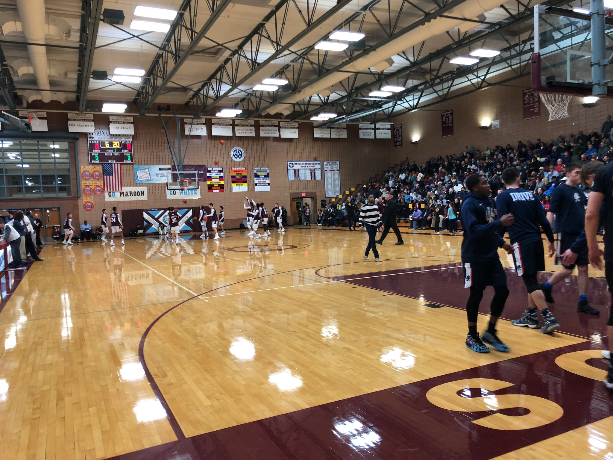 Okemos Boys Basketball Wins the CAAC Blue Conference Title