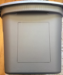 Step 2 in building an outdoor shelter for feral cats: Draw a 5 X 7 rectangle onto the bin leaving a few inches between the bottom line and the ground leve