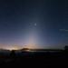 Zodiacal light on sky over mountain.