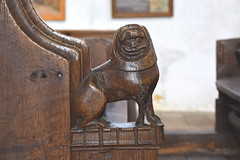 bench end: dog? with a woman's head (15th Century)