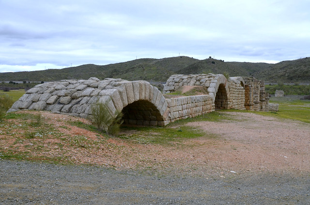 The 300 m long Alconétar Bridge over the Tajo River along the Vía de la Plata, a Roman segmental arch bridge erected in the early 2nd century AD by the emperors Trajan or Hadrian, possibly under the guidance of Apollodorus of Damascus, Spain