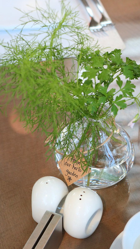 The herbs from the garden are used as tabletop centerpieces