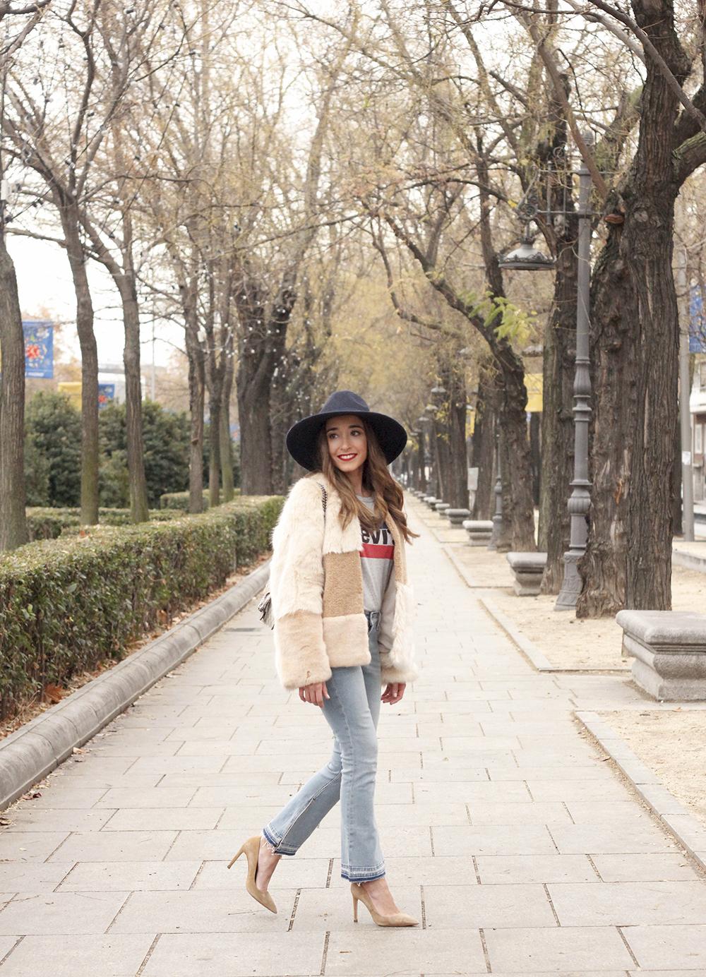 Beige faux fur coat zara blue hat nude heels jeans style fashion outfit winter 09