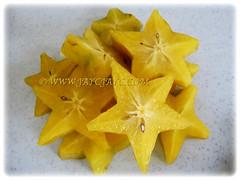 Star-shaped fruits of Averrhoa carambola (Star Fruit, Starfruit Carambola, Caramba, Country Gooseberry, Belimbing Manis in Malay) exposing its edible seeds, 31 Dec 2017