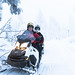 Small photo of Father and son snowmobiling