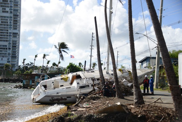 Hurricane Maria salvage crews remove wrecked boat from road