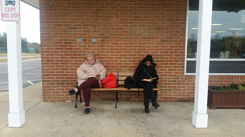 Calvert Library posted a photo:What do you do when you're waiting for the library to open? READ!
