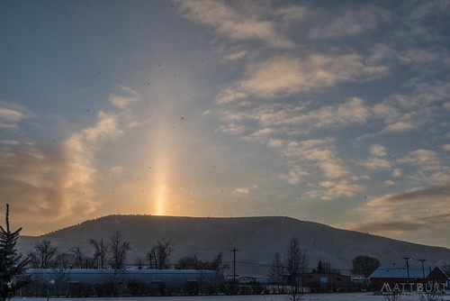 clouds lightpillars morning sky snow snowflakes sunrise wmountain