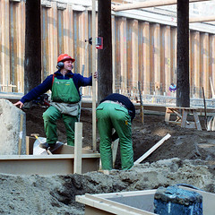 Men make formwork for concrete pouring
