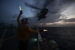 Aviation Boatswain Mate Handling Airman Ryan Sharland directs a Marine Corps UH-1Y Venom on the flight deck of USS San Diego (LPD 22), Dec. 28. (U.S. Navy/MC3 Justin A. Schoenberger)