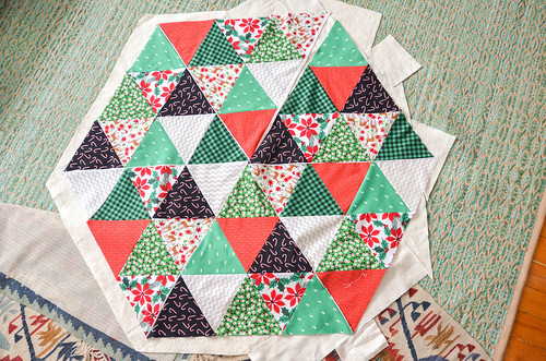 Put together ironed scraps of batting so that they're bigger than your quilt top