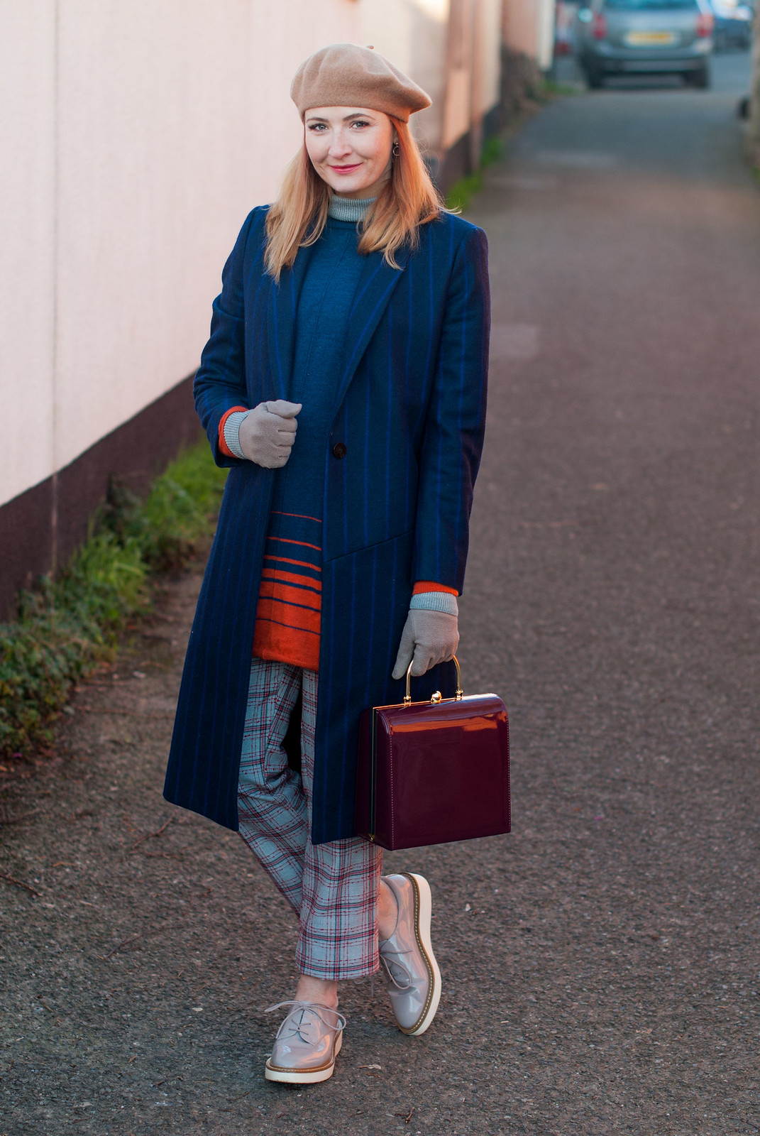 How to style a beret in winter: With a navy pinstripe wool coat, check trousers, a sweater dress and taupe lace ups | Not Dressed As Lamb, over 40 fashion blog