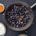 Blueberry compote with yogurt and puffed quinoa dessert ingredients.