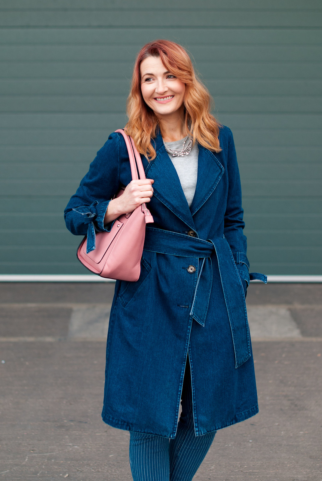 Winter to spring transitional outfit - Denim trench coat, pinstripe boyfriend jeans, white loafers, pink tote bag   Not Dressed As Lamb, over 40 style
