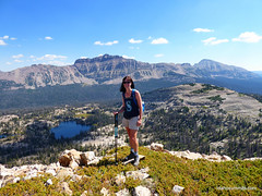 Carrie on Lofty Peak with Mount Hayden behind her