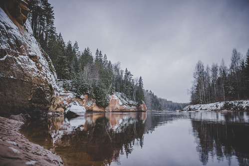 landscape latvia latvija nature outdoors river cliff sky clouds wood winter snow water reflection travel tree daylight